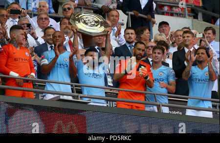 Sergio Aguero of Manchester City holds the trophy aloft during the Sky Bet League Two match between Crawley Town and Stevenge at the Broadfield Stadium in Crawley. 11 Aug 2018 - Stock Image
