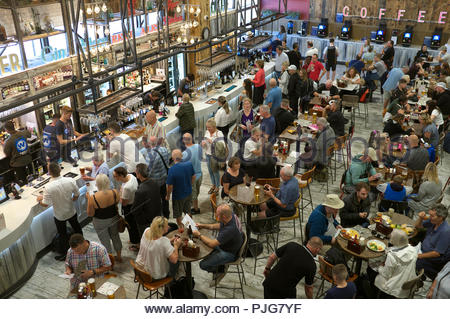 The Red Lion - JD Wetherspoons establishment at Gatwick Airport departure terminal, showing diners and drinkers awaiting their flights. Gatwick, UK. - Stock Image