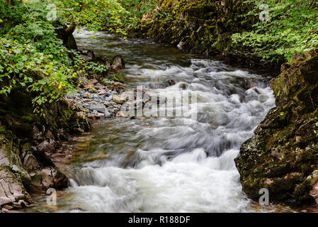 A turbulent section of the River Esk approaching Doctor Bridge, Eskdale, Cumbria, UK - Stock Image