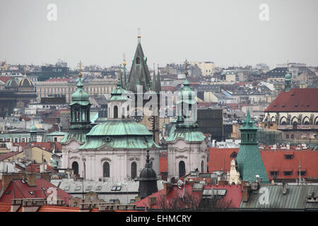 Saint Nicholas' Church in Old Town Square and the Old Town Hall viewed from the Letna Park in Prague, Czech - Stock Image