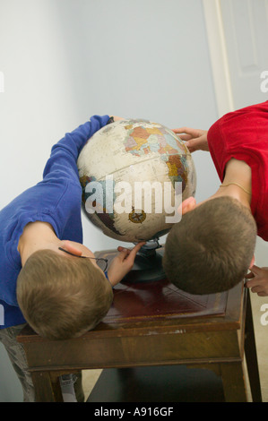 Boys looking at Globe - Stock Image