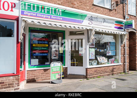 A photographer's studio shopfront with displays and prominent Fujifilm logo. - Stock Image