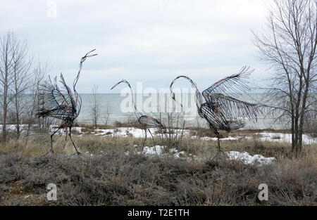 Metal sculpture, Dancing Sand Hill Cranes, by Jim Dehne on public display by Mariners Trail on Lake Michigan at Two Rivers, Wisconsin. - Stock Image