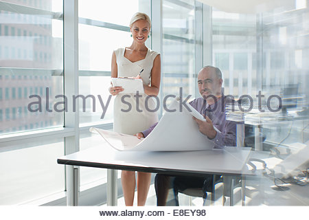 Business people working together in office - Stock Image