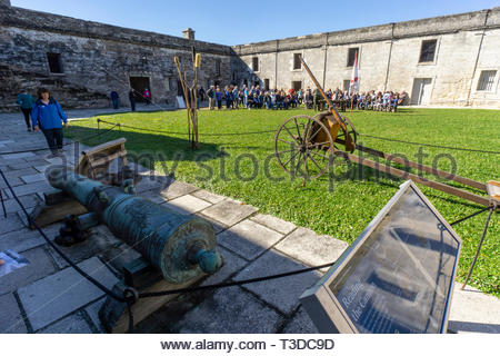 Weapons on display in the courtyard as a park ranger delivers a lecture at the Castillo de San Marcos, a Spanish fortification at St. Augustine, Flori - Stock Image