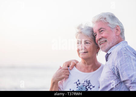 Together forever life and new horizon for a retired couple happy in outdoor hugging and loving  happy old prople holding hands and enjoy - white brigh - Stock Image