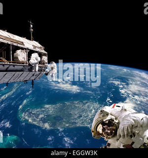 A team of astronauts performing work on a space station while orbiting above Earth. Florida and the Bahamas are - Stock Image