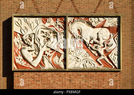 Man's Struggle by Walter Richie artwork panel outside the Herbert Art Gallery and Museum in Coventry city centre UK - Stock Image
