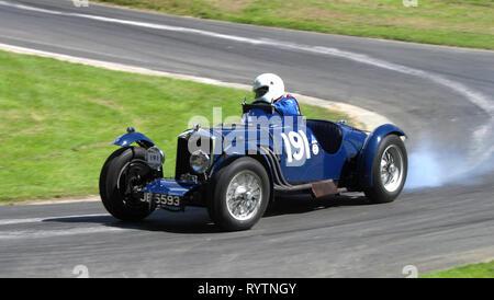 1935 Riley 12/4 TT Sprite replica competes with the VSCC at Prescott Hillclimb. - Stock Image