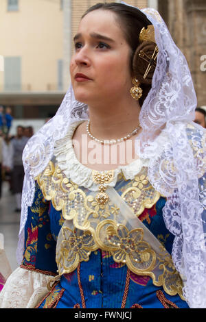 Woman in traditional costume during the offering procession to the Holy Lady of the Forsaken Valencia Spain - Stock Image