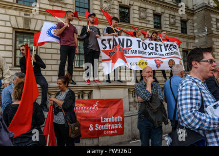 London, UK. 13th October 2018. GIK-DER Turkish Migrant Workers Cultural Association stand with their banner at the  rally in London close to where the racist, Islamophobic DFLA were ending their march on Whitehall bringing together various groups to stand in solidarity with those communities the DFLA attacks. The event was organised by Stand Up To Racism and Unite Against Fascism. Peter Marshall/Alamy Live News - Stock Image
