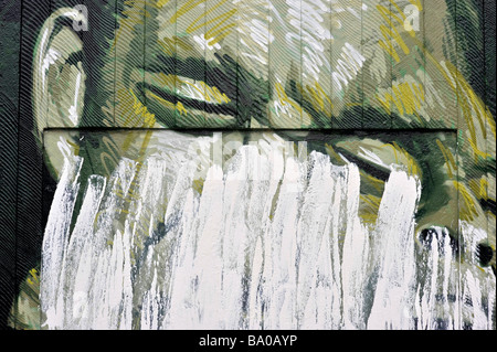 defaced northern quarter graffiti face - Stock Image