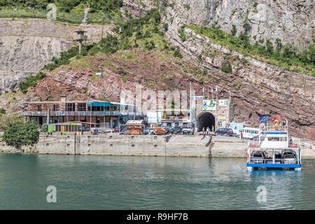 Views tunnel entrance to and Lake Koman Ferry, Albania - Stock Image