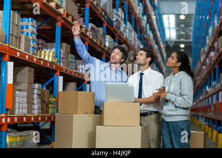 warehouse, storehouse, storage, goods, stock, worker, manager, staff, colleagues, team, well dressed - Stock Image