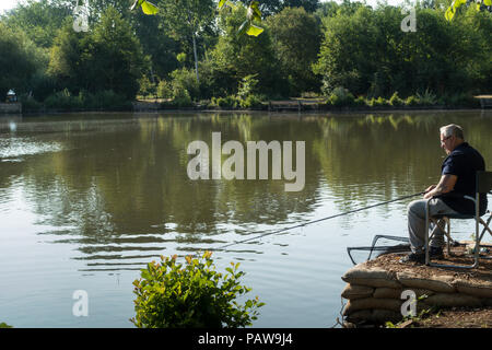 Henlow, Bedfordshire, UK, 25th July 2018. Angler Bob set up very early before the heat becomes too much for him. Credit: Mick Flynn/Alamy Live News - Stock Image