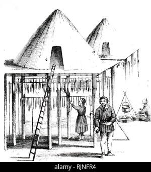 An engraving depicting the inhabitants of Kamchatka and their summer hut or Balagan, with fish hanging up to dry for winter use. Dated 19th century - Stock Image
