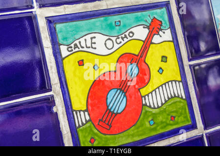 Miami Florida Little Havana Calle Ocho Maximo Gomez Domino Park tile mosaic colorful blue yellow red hand painted guitar musical - Stock Image