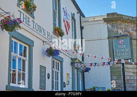 The Town Hall Inn Richmond, with hanging baskets and bunting. - Stock Image