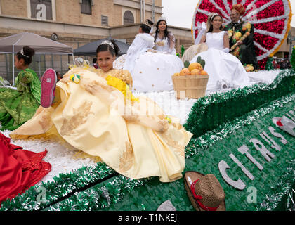 'Royalty' ride on citrus-themed float celebrating the area grapefruit industry during a three-hour parade through Laredo, Texas. - Stock Image