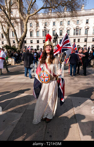 A Lady, dressed as Britannia, stands in Parliament Square, to demonstrate against the delay to Brexit  on the day the UK should have  left the EU - Stock Image