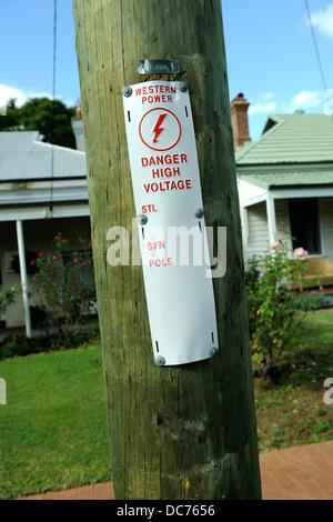 Warning tag on light-pole, Perth, Western Australia - Stock Image