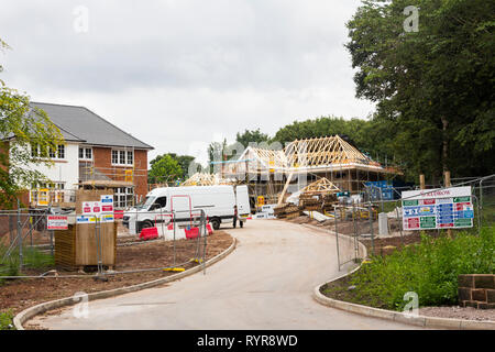 New houses under construction construction by Redrow at Smalley Avenue, Woolton, Liverpool. The photo is taken from Beaconsfield Road,  almost opposit - Stock Image