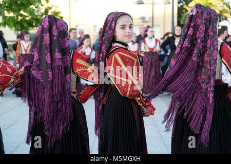 People in colourful costumes during the Festa di San Simplicio, Sardinia, Italy - Stock Image