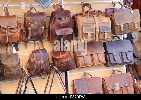 Market stall selling leather bags in Old Corfu Town, Corfu, GREECE, PETER GRANT - Stock Image