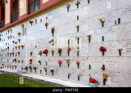 Miami Florida Little Havana Graceland Cemetery grave burial vault death flowers vertical marble markers memorial - Stock Image