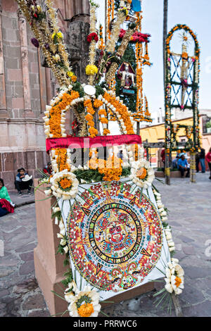 Giant Xuchiles, complex braided offerings made from called agave fibers and marigolds, on display at the Parroquia San Miguel Archangel Church celebrating the cities patron saint during the Feast of Saint Michael September 30, 2018 in San Miguel de Allende, Mexico. The festival is a four-day long event with processions, parades and a late night fireworks battle. - Stock Image