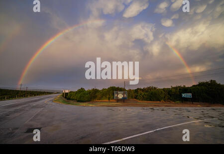 Full rainbow over the entrance sign to the Addo National Park in South Africa - Stock Image