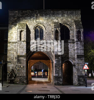Winchester, England, UK - April 22, 2019: The Westgate of Winchester's mediaeval town walls is lit at night. - Stock Image