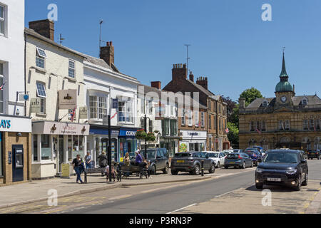 The High Street of the market town of Towcester, Northamptonshire, UK - Stock Image