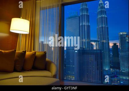 Petronas Towers at twilight (from Grand Hyatt), Kuala Lumpur MY - Stock Image