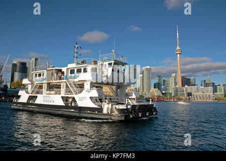 Toronto Billy Bishop Toronto City Airport mainland lounge with passenger ferry coming towards the island with downtown - Stock Image