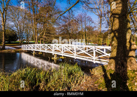 Wooden Bridge in the snow at Stowe, Buckinghamshire, UK - Stock Image