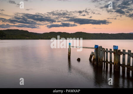 Sunset at Lettes Bay on Maquarie Harbour, near Strahan on the West coast of Tasmania - Stock Image