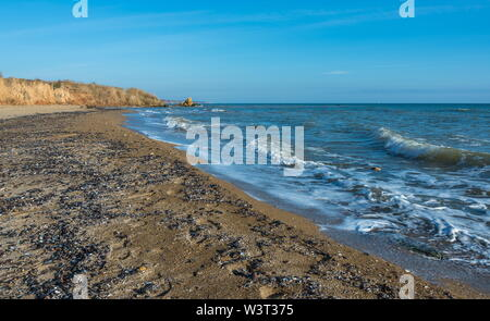Sea coast dotted with mussel shells on the seashore near Odessa, Ukraine - Stock Image