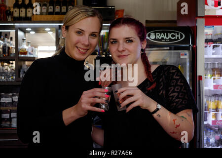 young female bar staff taking a break from work in the dallas bar lenti zala county hungary - Stock Image