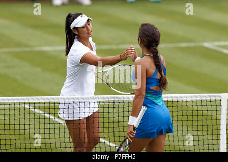 Priscilla Hon (left) and Ankita Raina (right) shake hands at the end of Hon's Women's Singles qualifying win at the 2018 Nature Valley Classic in Birmingham, UK. - Stock Image