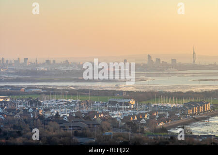 View from Portsdown Hill at dusk over Portsmouth and Port Solent and the Portsmouth skyline in the distance, Portsmouth, Hampshire, UK - Stock Image