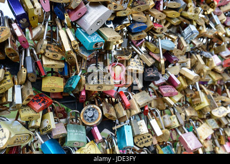 Love locks and a baby dummy attached to Pont Neuf,  Paris. - Stock Image