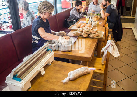 A woman preparing foie gras entier, whole goose liver, Le Louchebem restaurant, Marché Victor Hugo, Toulouse, - Stock Image