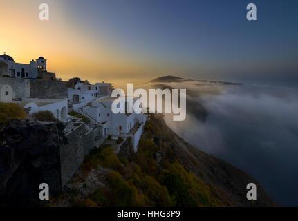 Foggy sunrise at Imerovigli , Santorini - Stock Image