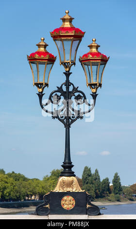 Old gas lamps on Putney Bridge, Putney, London Borough of Wandsworth, Greater London, England, United Kingdom - Stock Image