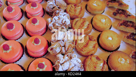 View of different varieties of cakes and pastries at a food market - Stock Image