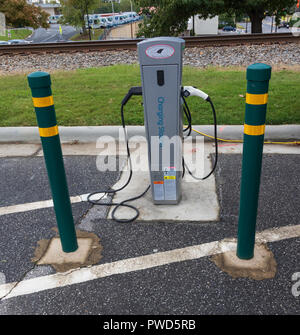 HICKORY, NC, USA-10/14/18: A free charging station for electric vehicles in parking lot on the square in downtown. - Stock Image