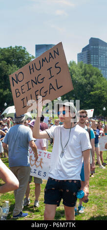 Boston, Massachusetts, USA. 30th June, 2018.  U.S. Demonstrator holding a sign as thousands gathered in the Boston Common in Boston, MA during the Rally against Family Separation by the current United States administration. Rallies against U.S. President Donald Trump's policy of the detention of immigrants and immigrant families separated by U.S. customs and border agents (I.C.E.) took place in more than 750 US cities on June 30th. - Stock Image