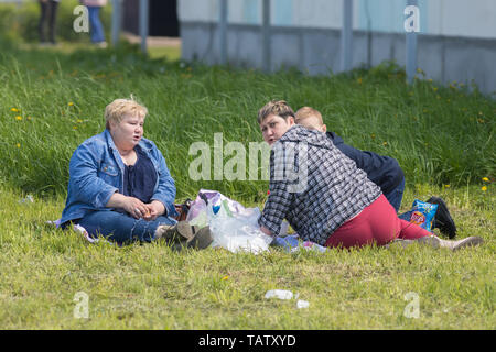 RUSSIA, Nikolskoe village, Republic of Tatarstan 25-05-2019: Three mature overweight women sitting on the blanket in a village and having a picnic. An - Stock Image