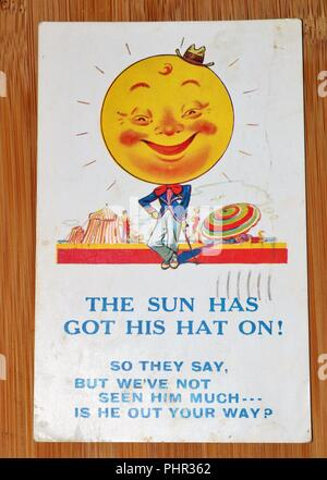 Vintage 1930s Postcard by Bamforth & Co Comic Series showing the sun - the Sun Has Got His Hat On! - Social History - Stock Image